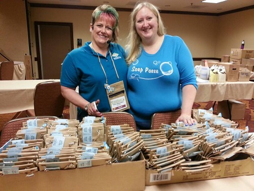 Tricia and Renee getting badges ready